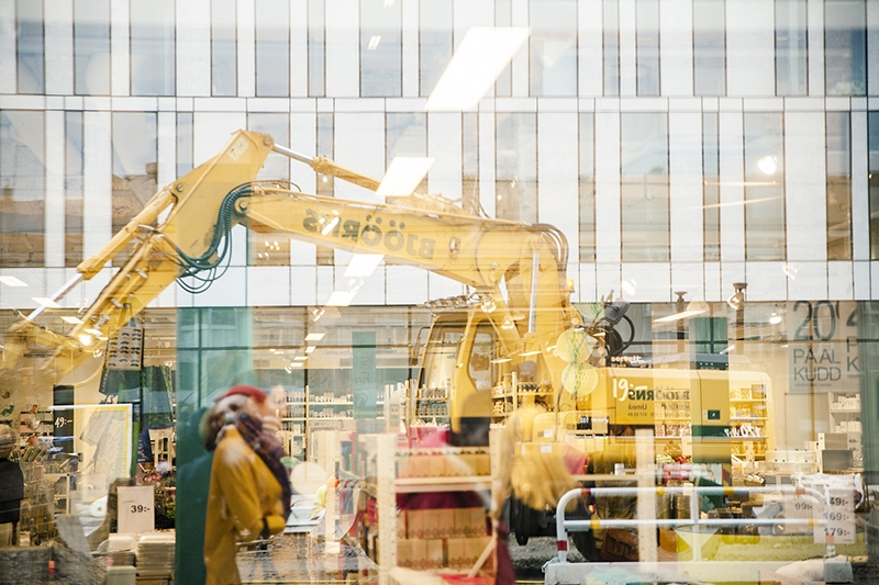 Excavator digging outside the mall Utopia